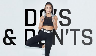 Chloe Standing and leaning on a wall with the words 'Do's and Dont's' On the back ground